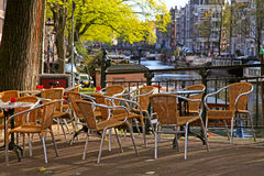 Sidewalk cafe on bridge of canal in Amsterdam Royalty Free Stock Photo