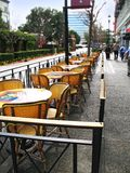 Sidewalk Cafe on Overcast Day. Empty sidewalk cafe on an overcast day royalty free stock images
