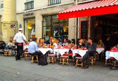 Sidewalk Cafe Paris France. Relaxing at Paris sidewalk cafe for mid day meal Royalty Free Stock Photography