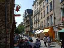 Sidewalk cafe in a street market, Dinan, Royalty Free Stock Photography