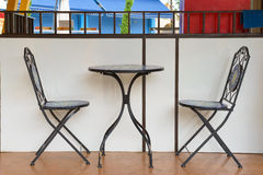 Sidewalk cafe - table and chair Stock Photography