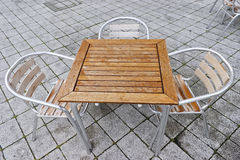 Sidewalk cafe table and chairs. Stock Photo