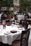 Sidewalk cafe. With white table cloths and maroon napkins Stock Images