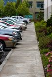 Sidewalk with cars parked in a row royalty free stock photography