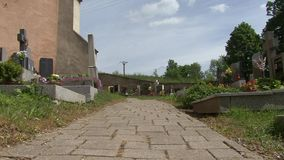 Sidewalk in the cemetery. Slider dolly shot stock footage