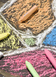 Sidewalk Chalk. A colorful display from a child hard work. Coloring the driveway with chalk Royalty Free Stock Images