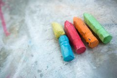 Sidewalk Chalk on Concrete Texture Royalty Free Stock Photography