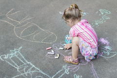 Sidewalk chalk drawings of little Caucasian girl wearing pink ruffle skirt. With floral pattern Royalty Free Stock Images