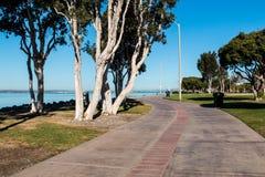Sidewalk Through Chula Vista Bayfront Park. Sidewalk through the Chula Vista Bayfront Park with the San Diego Bay in the background Stock Image