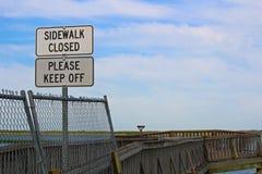 Sidewalk closed, please keep off signs closing a sidewalk Stock Images