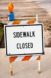 Sidewalk closed sign. A road sign sidewalk closed in front of a road work. the text can easily be erased. put your own text there stock photo