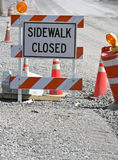 Sidewalk closed sign. In a construction zone royalty free stock photography