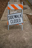 Sidewalk Closed Sign Askew with Copy Space Below Stock Image