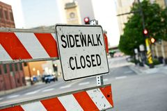Sidewalk Closed. Sign and Road Barricade Royalty Free Stock Photo