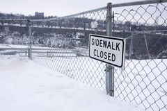 Sidewalk closed sign in snow Stock Image