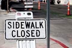 Sidewalk closed signs. Closing a sidewalk Stock Images