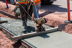 Sidewalk Construction. Construction process in the making of a freshly pored cement sidewalk Stock Image