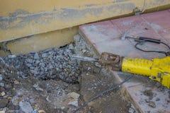 Sidewalk crack repairing Stock Photos
