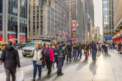 Sidewalk Crowded with People during the Christmas Holidays. New York, NY, USA - December 27, 2014: Sixth Avenue in Midtown Manhattan packed with Locals and Royalty Free Stock Photography