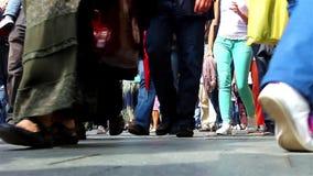 Sidewalk. The feet of dozens of pedestrians walking on the sidewalk stock footage