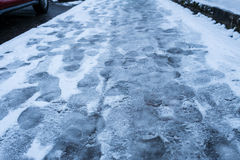 Sidewalk with footprints in the snow Royalty Free Stock Photography