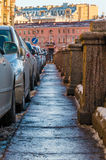 Sidewalk on granite embankment of canal. Sidewalk and parked cars on a granite embankment of Griboyedov Canal, St. Petersburg, Russia Stock Images