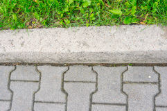 Sidewalk and grass Stock Photography