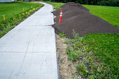 Sidewalk landscaping with topsoil Royalty Free Stock Photo