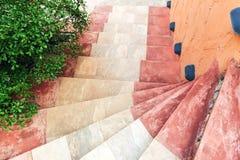 Sidewalk lantern with spiral stairway. Top view of sidewalk lantern with stone spiral stairway Stock Photos