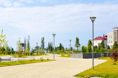 The sidewalk with lanterns. Along the road there are lights and buildings Royalty Free Stock Photos