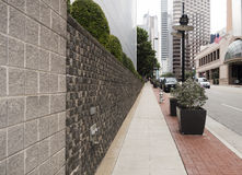 Empty long, straight sidewalk in one-point perspective Stock Photos