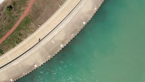 Aerial view people on walkway lake Michigan Chicago stock video