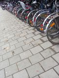 Sidewalk with many bicycles at bike stand Royalty Free Stock Images