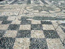 Sidewalk Mosaic. A cobblestone mosaic on a sidewalk in Tinos island, Greece stock photos