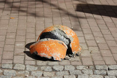 Sidewalk near the house and orange shattered hemisphere parking strengthened against the entry of vehicles. Relevant when the dang. Er of terrorist attacks Royalty Free Stock Photo