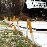 Sidewalk near the house and white yellow parking pole stationary strengthened against the entry of vehicles. Relevant when the dan. Ger of terrorist attacks Stock Image