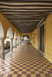 Sidewalk and old Mexican colonial archways in Valladolid, Yucatan Peninsula, Mexico Royalty Free Stock Photo