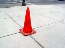 Sidewalk and Orange Cone. Orange traffic cone on Spokane sidewalk royalty free stock image