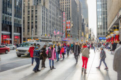 Sidewalk packed with Locals and Tourists during the Christmas Holidays Royalty Free Stock Image
