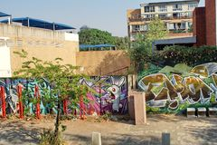 Sidewalk by a painted wall in Braamfontein stock photography
