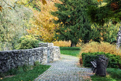 Sidewalk in the park and colorful trees in autumn Stock Photography