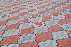 Sidewalk pattern. Of grey and red colors. A background. Shallow DOF Royalty Free Stock Photography