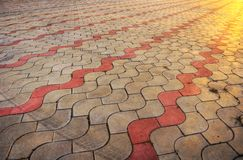 Sidewalk pile pattern in sunset - HDR picture. Sidewalk pile pattern with track of protector in sunset - HDR picture Royalty Free Stock Photos