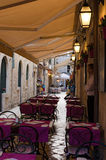 Sidewalk restaurants, Dubrovnik. DUBROVNIK, CROATIA - MAY 15, 2013: tables of a street restaurant in the old town of Dubrovnik. On 15 May 2013 in Dubrovnik Stock Images