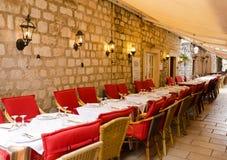 Sidewalk restaurants, Dubrovnik. DUBROVNIK, CROATIA - MAY 16, 2013: tables of a street restaurant in the old town of Dubrovnik. On 16 May 2013 in Dubrovnik Royalty Free Stock Photo