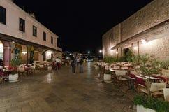 Sidewalk restaurants, Dubrovnik. DUBROVNIK, CROATIA - MAY 16, 2013: tables of a street restaurant in the old town of Dubrovnik. On 16 May 2013 in Dubrovnik Stock Image