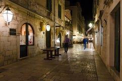 Sidewalk restaurants, Dubrovnik. DUBROVNIK, CROATIA - MAY 16, 2013: tables of a street restaurant in the old town of Dubrovnik. On 16 May 2013 in Dubrovnik Royalty Free Stock Images