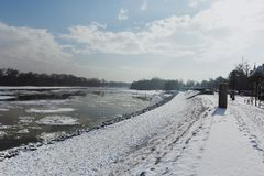 Sidewalk and river dam covered with slush and snow in Szentendre, Hungary royalty free stock photos