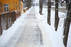 Sidewalk in the snow-covered street Royalty Free Stock Images