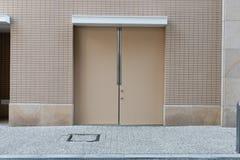 Roll up garage door on brick wall. Old weathered roll up garage door on brick wall royalty free stock photo